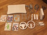 Nintendo Wii bundle with Fit board, games, wheels, and controllers