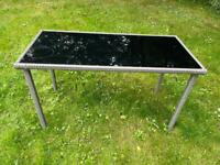 Grey rattan table with glass top