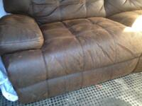 2 seater brown leather recliner sofa.