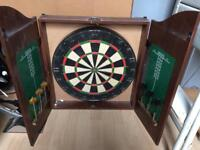 Dartboard in Cabinet with darts