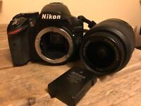 Nikon D3200 DSLR with 18-55mm lens and book