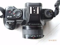 35MM CAMERA WITH TELEPHOTO LENS AND FLASH