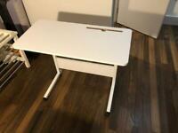 Adjustable-height desk