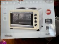 Mini Oven never been used. Still in box.