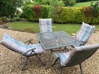 Garden Table and Matching 4 Reclining Chairs with Padded Seat Cushions