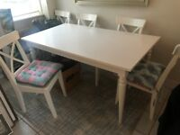 White dining room table (extendable) and 6 chairs
