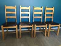 Four oak chairs - ladder back - leather seats