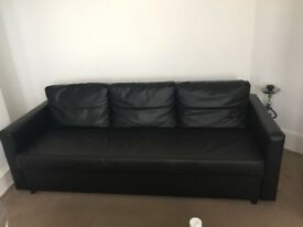 1.5 years old Black Leather Couch with hidden bed + storage