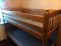 Solid pine bunk beds with mattresses