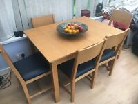 Extending beech Christmas dining table & 5 chairs