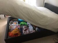 Double bed with storage space and mattress