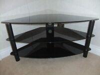 Black glass corner TV stand - very good condition