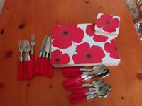 Red cutlery set and tablemats