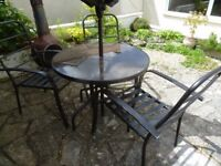 Metal/Glass Patio table, metal chairs and mechanical fabric parasol