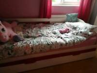 White wooden trundle bed