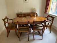 Good quality yew wood extending dining table and chairs