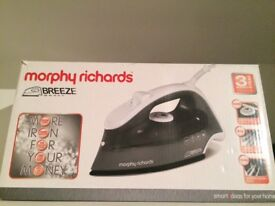 New in box steam iron morphy Richards