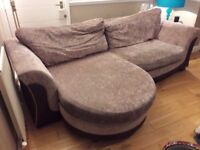 Sofa with extended leg area and swivel chair