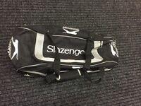 Slazenger cricket kit bag with wheels.