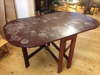 Solid wood 6-seater folding dining table.