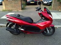 2012 Honda PCX 125 automatic scooter, new 1 year MOT, very good runner, new rear tyre and battery,,,