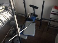 Bench with 100kg weights and attachments