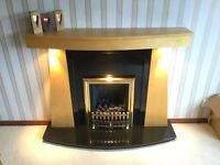 Living Flame gas fire with wood surround and granite hearth.
