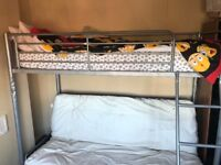 Bunk beds with sofa underneath which turns into double bed