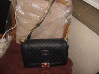 Black quilted Boy bag
