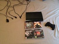PS3 Super Slim Console with 1 control and 4 games.
