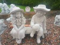 Concrete Boy and Girl Sitting on Seat Garden Ornament