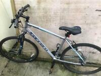 Silver and blue mountain bike