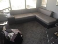 good condition leather corner suite with pull out bed and 7ft of storage