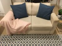 Cream two seat sofa