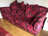 Beautiful vintage red sofa armchair and footrest