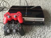 PS3 w/ 5 games and remote.