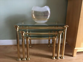 Nest of 3 glass topped/brass leg coffee tables
