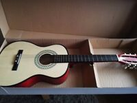 Child's guitar in box opened once but unused