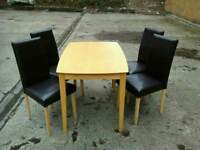 Light wood table with 4 brand new high back chairs