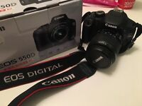 Canon 550d with Zoom EF-S18-55mm kit lens, camera bag and spare battery.
