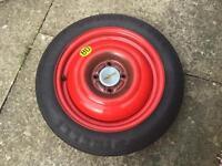 "Pirelli space saver 15"" spare wheel T125/80 R15, jack & towing eye."