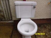 Toilet in white.