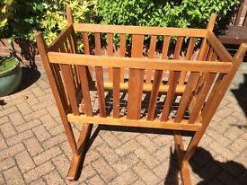Hand made wooden rocking cradle.