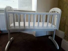 White wooden crib with rocking action.