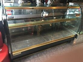 a used but in good condition Mafirol cake, food display cabinet
