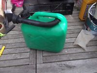green unleaded plastic petrol can with filler nozzle