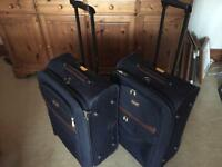 2 suitcases (navy medium size) with brown leather effect trim