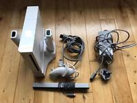 Wii with 2 controllers, nunchuck, rechargeable batteries and charging syand