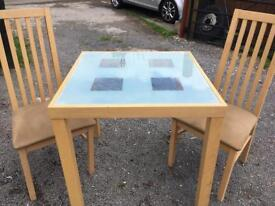 Square glass top table with 4 chairs. Solid