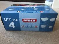 Brand new Pyrex set of 4 roaster and casserole set.